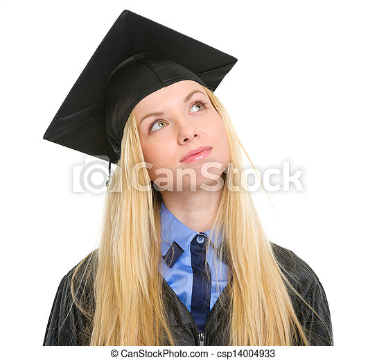 Young woman in graduation gown looking up on copy space - csp14004933