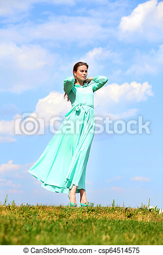 Young woman in green dress - csp64514575