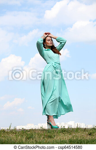 Young woman in green dress - csp64514580
