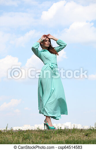 Young woman in green dress - csp64514583