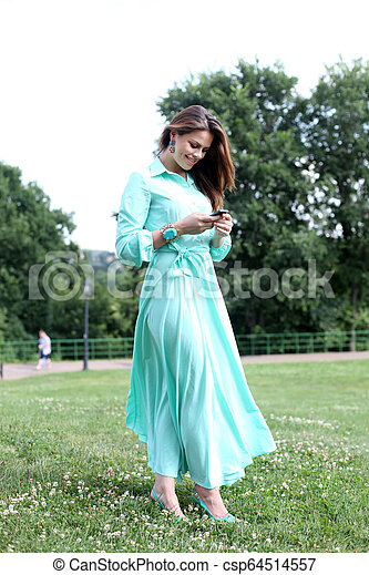 Young woman in green dress - csp64514557