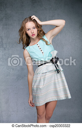 Young woman in green dress - csp20303322