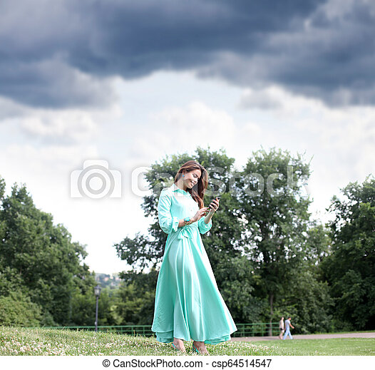 Young woman in green dress - csp64514547