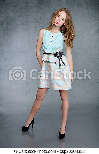 Young woman in green dress - csp20303333