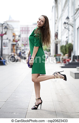 Young woman in green dress - csp20623433