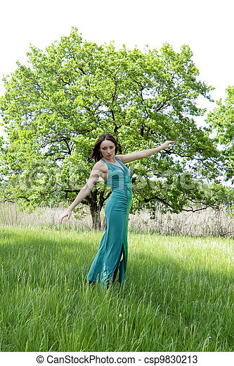 Young woman in green dress - csp9830213