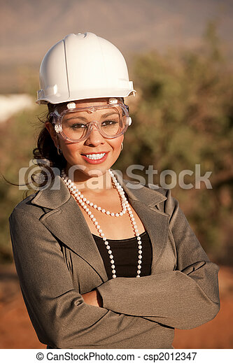 young woman in hard hat and safety goggles pretty young woman in