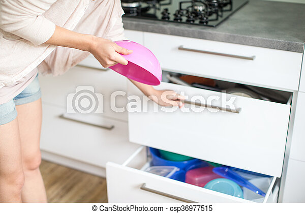 Young woman in her lovely, modern kitchen - csp36977515
