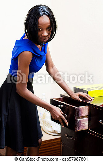 Young woman in her office - csp57987801