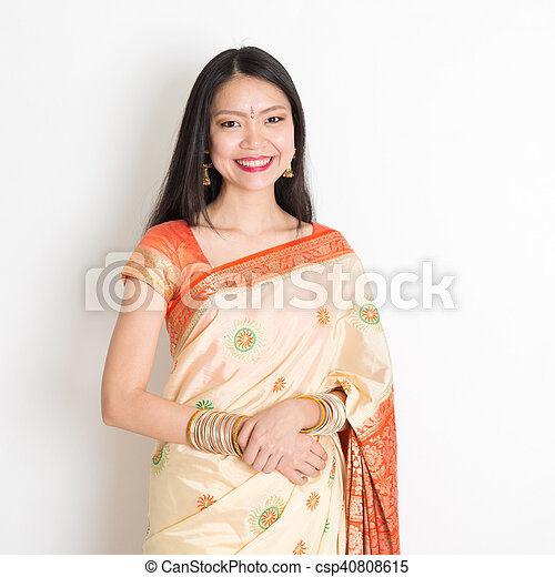 2ccb7fbaec Young woman in indian sari. Portrait of young mixed race indian ...