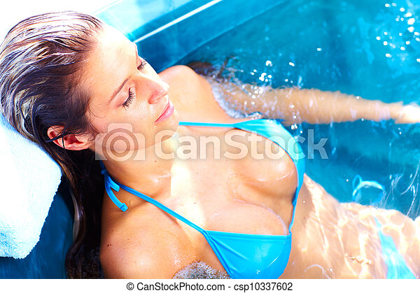 Young woman in jacuzzi. - csp10337602
