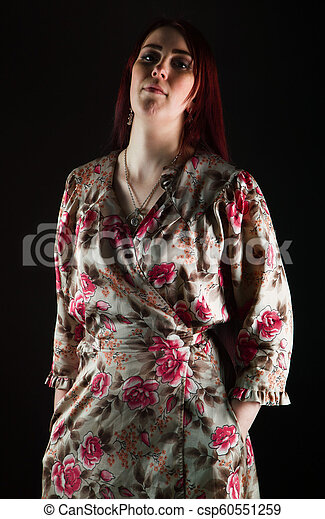 Young woman in peignoir with red hair - csp60551259