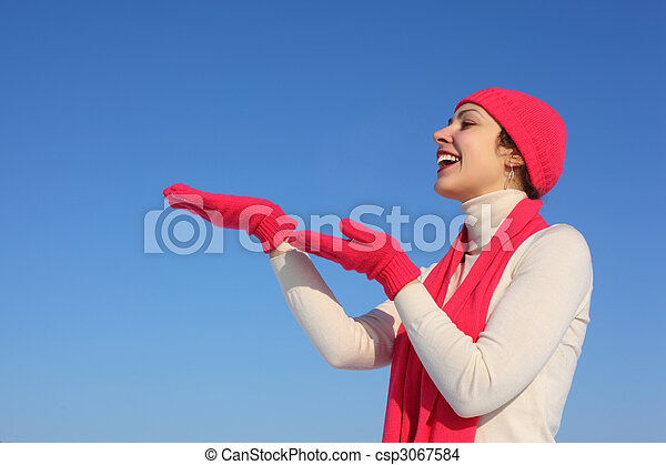 Young woman in red gloves - csp3067584