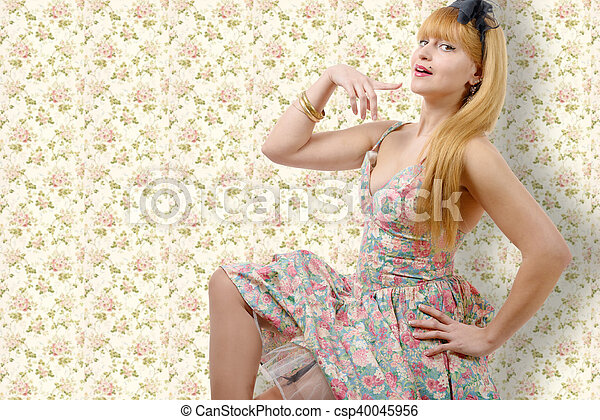 Young woman in retro floral dress - csp40045956