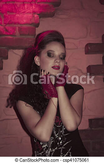 Young woman in rock style clothing. Studio shot - csp41075061