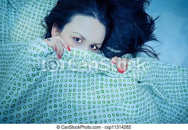 Young woman in the bed - csp11314282