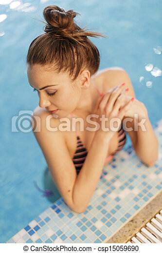 Young woman in the swimming pool - csp15059690