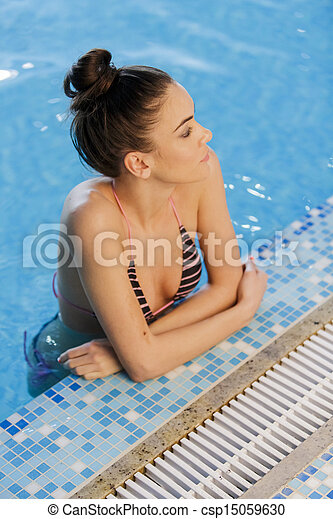 Young woman in the swimming pool - csp15059630