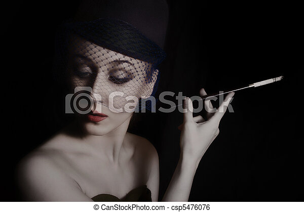 young woman in veil with cigarette - csp5476076