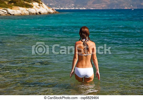young woman in white bikini - csp6829464