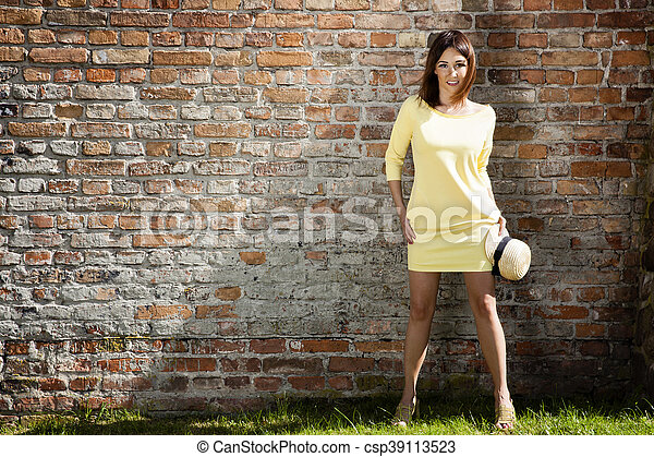 Young woman in yellow dress - csp39113523