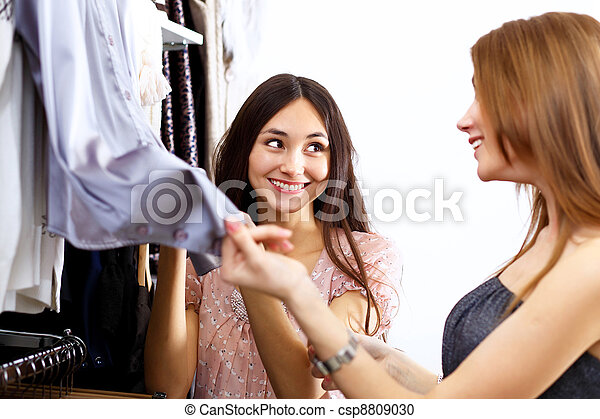 Young woman inside a store buying clothes - csp8809030