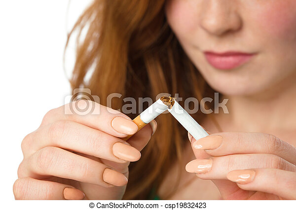 Young woman is breaking a cigarette - csp19832423