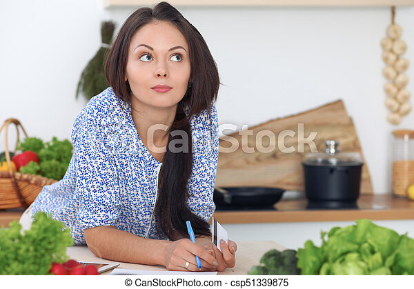 young woman is making online shopping by tablet computer and