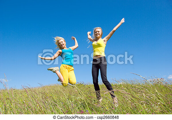 young woman jumping on background blue sky - csp2660848