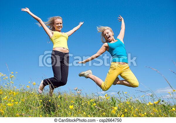 young woman jumping on background blue sky - csp2664750