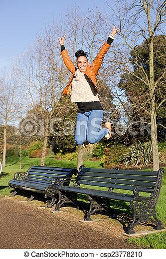 young woman jumping - csp23778210