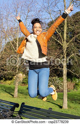 young woman jumping - csp23778239