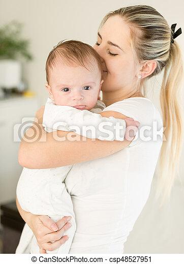 Woman kiss boy