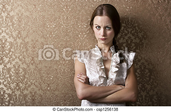 Young Woman Leaning Against a Wall - csp1256138