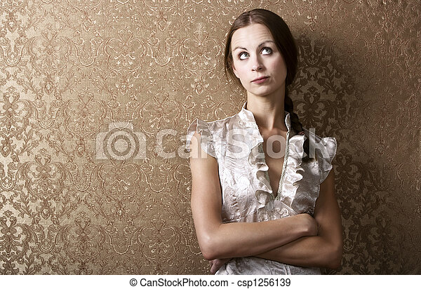 Young Woman Leaning Against a Wall - csp1256139