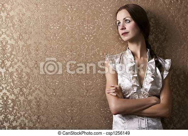 Young Woman Leaning Against a Wall - csp1256149