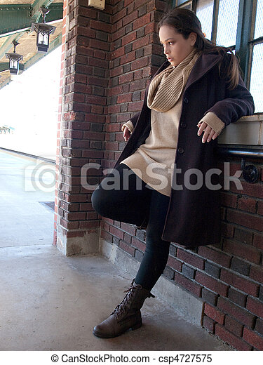 Young Woman Leaning Against Wall