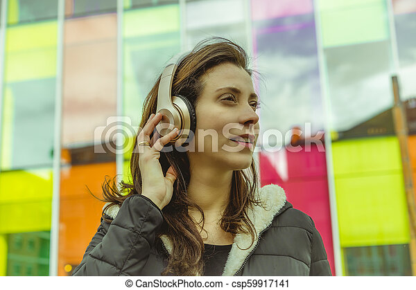 Young woman listening to music - csp59917141