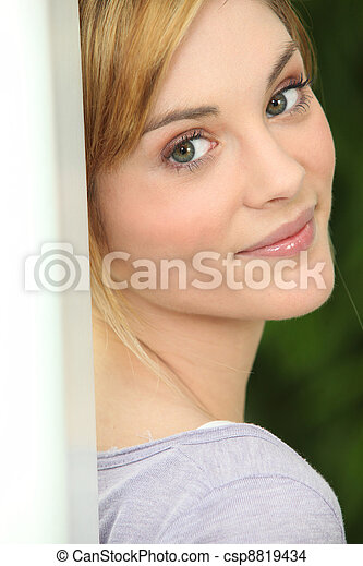 Young woman looking over her shoulder - csp8819434
