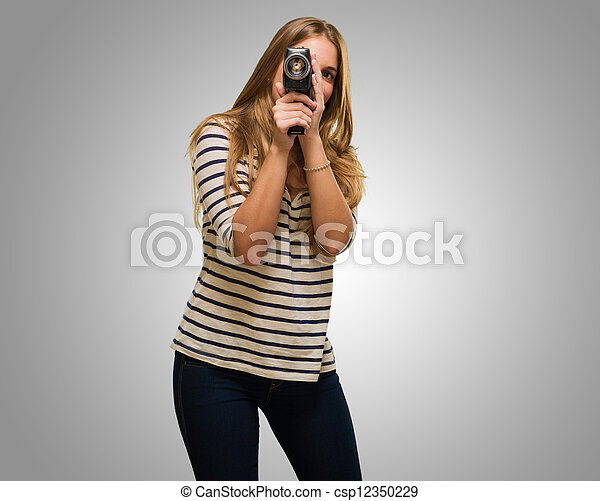 Young Woman Looking Through A Camera - csp12350229