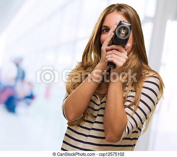 Young Woman Looking Through A Camera - csp12575102