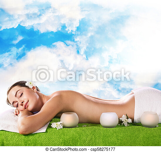Young woman lying on the table and waiting massage. - csp58275177