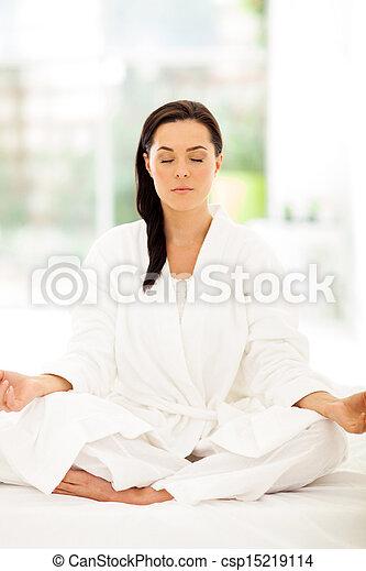 young woman meditating  - csp15219114