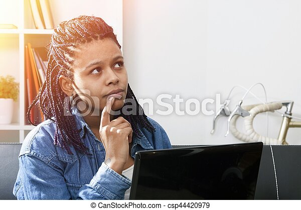 young woman modern with computer laptop on the sofa of the apartment - csp44420979
