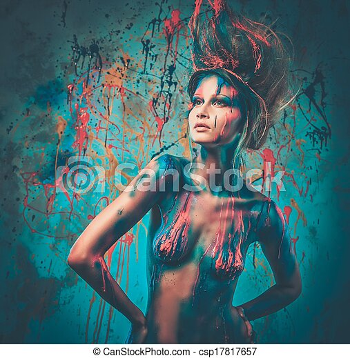 Young woman muse with creative body art and hairdo  - csp17817657