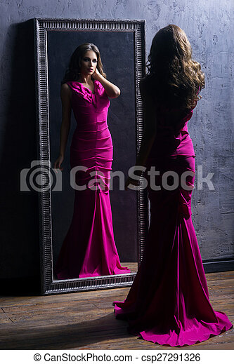 Young woman next to a mirror - csp27291326