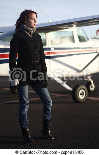 Young woman next to airplane - csp4916486