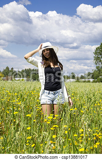 Young woman on a field of flowers - csp13881017