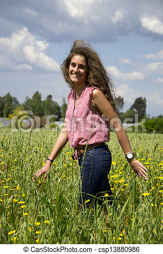 Young woman on a field of flowers - csp13880986