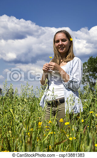 Young woman on a field of flowers - csp13881383